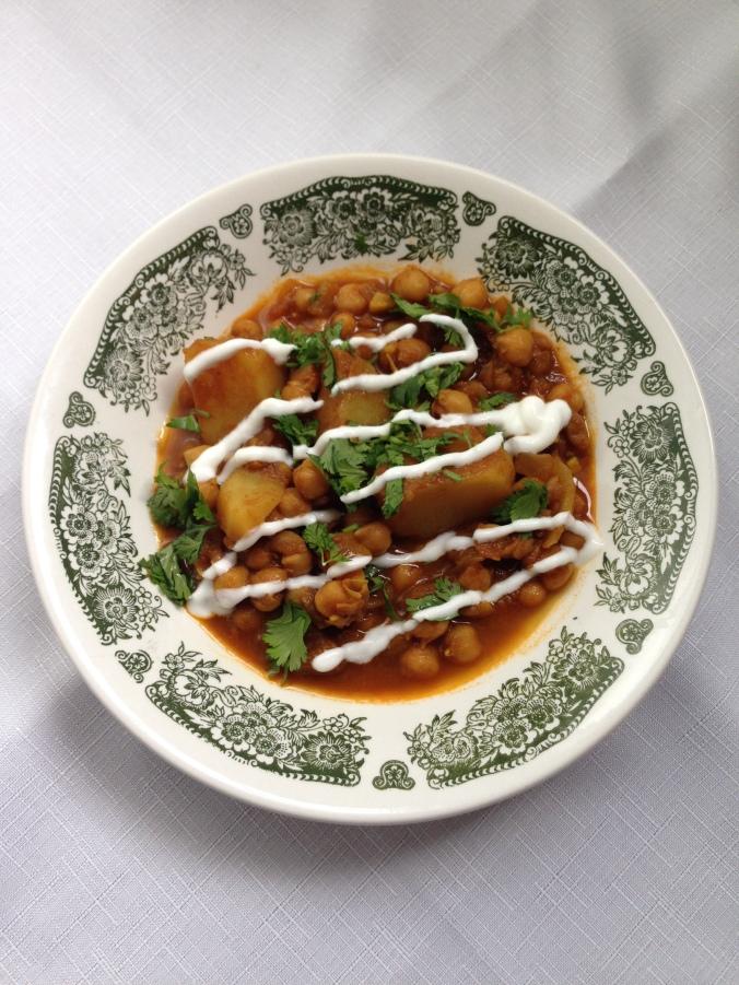 chana masala with cilantro and yogurt