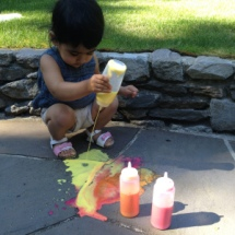 "Here Raman (of Toddler Tales) set up a ""Squirting Fire"" activity for her daughter"
